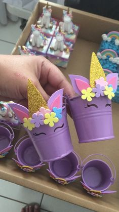 These are super cute purple buckets turned into mini unicorns. Perfect for goody bags! Great for a unicorn party.
