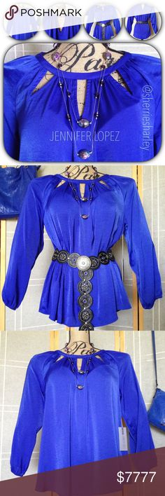 Blue Jennifer Lopez City Lights L/S Blouse NWT Gorgeous color pop when you wear this City Lights top by Jennifer Lopez. Great style piece for your wardrobe. Features peak-a-boo front design & back neckline has silver accent piece to complete her flowing, sexy design. Elastic gathered cuffs for a softer finish. Woman's Plus NWT.  PRICE firm unless bundled. Jennifer Lopez Tops Blouses