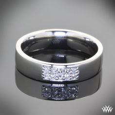 Men deserve diamonds too - This Custom Diamond Wedding Ring is set in platinum and holds 10 bead-set diamonds along the front. The flat comfort fit design ensures easy all day wear.