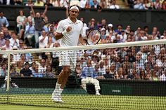 Roger Federer celebrates on Centre Court