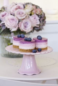 Triple Berry Cheesecakes - love the ombre effect! #food #berries #cheesecake #purple  Flowers in the background are awesome too