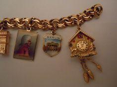 14K Charm Bracelet with Nine Travel Theme Charms.  via Etsy.