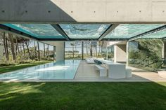 """The Wall House by Guedes Cruz Arquitectos Architects:Guedes Cruz Arquitectos Location:Cascais, Portugal Year: 2013 Photo courtesy:Ricardo Oliveira Alves Description: """"Like a wall in a Castle not in stone, but in concrete, glass and wood. Not to for protection but because of the neighbours and the strong Atlantic Wind. A Patio house with a Mediterranean country …"""