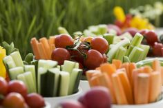 Bite sized fruit & veg in cups for finger foods at a party.