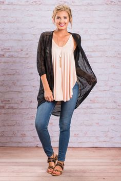 There is just something about this cardigan that we just cannot resist!! Maybe it's because it's solid sheer crochet! We love the fact that you can see the colors of your top or dress through the cardi! Or maybe it's because of it's loose, flowing boho fit! Whatever it is, we just know you will love it too!