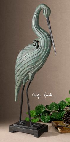 the statuesque heron is depicted here with a blue green crackled finish light gray glaze and matte black accents