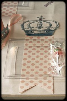 Princess Party ~ The Royal Setting.  We rolled out the tabletop 'white carpet'...of butcher paper.  Each royal plate...sat atop a dove-tailed runner...an embellished vintage inspired crown...marking the Royal Highness...seat of honor.