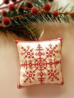Cross Stitched Folk Art Ornament - snowflake. $9.00, via Etsy.