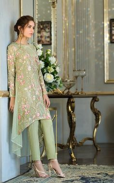 Fully embroidered net tail style shirt with sequence work & pearls embellishment on back of shirt & sleeves. Stylish Dresses For Girls, Stylish Dress Designs, Girls Dresses, Frock Fashion, Girl Fashion, Ethinic Wear, Pakistani Formal Dresses, Frock Design, Party Wear Dresses