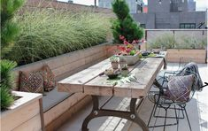 Wooden outside terrace / soft and cosy with natural pieces.