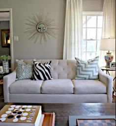 Living Room Color - Behr Wheat Bread! I have used this color in my last 3 houses and recommend it to anyone who wants a versatile, classic color. ITs tan/gray and looks great with white trim.