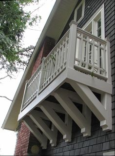 Similarities to her first home design can be seen above in the dormer windows, strong roof corbels, and square bump out window seat in the living room. House With Balcony, Porch And Balcony, Bedroom Balcony, Patio Roof, Apartment Balconies, Cool Apartments, Home Design, Cozy Studio Apartment, Dormer Windows