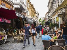 Picture of people walking through old town Bucharest