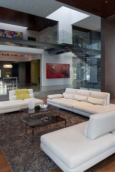 """Very modern, but this still feels """"homey"""" to me. I like the use of the large artwork pieces."""