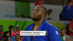 President of the Trinidad & Tobago Olympic Committee Brian Lewis praises Christopher George despite losing in Judo to Yan Naing Soe of Myanmar