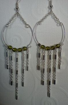Emerald Swarvoski beads on silver plated chain. Earrings by AvasoleilJewelry on Etsy, $25.00