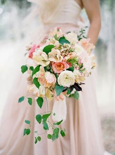 """""""Peaches and Cream"""". Feminine peach and ivory bouquet with a wisp of cascading foliage."""