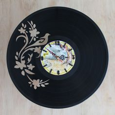Handcarved bird and flowers vinyl record clock, record clock, vinyl art clock…