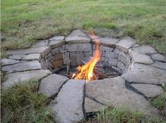 Great permanent fire pit. Make it large enough to put a grill grate on one side, and surround with log benches.
