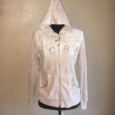Large bcbg velour hoodie tan /cream bling Great shape bcbg tan velour hoodie. Satin trim pockets. Size large but runs small. BCBG Tops Sweatshirts & Hoodies