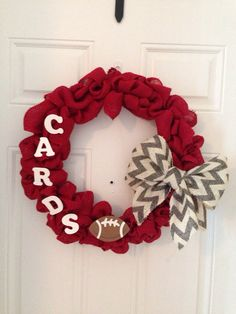 Game day wreath. Not a fan of the burlap but love the bow and football!