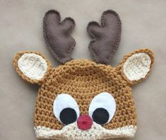 Materials:– Lion Brand Vanna's Choice worsted weight yarn in Honey (for the main hat) and Beige (for the snout)– 1 piece of dark brown felt– 1 piece of white felt– 1 piece of black...