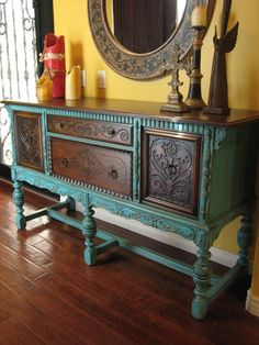 Visually stunning old world European antique sideboard. Rockford Republic. Quality solid oak with a rich dark stain on top and front panels. Striking turquoise/teal weathered finish. Beautiful hand-carved details throughout. A must-see in person to fully appreciate.