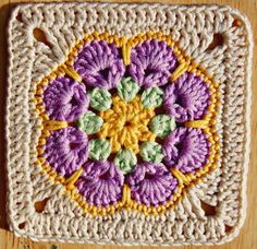 Pretty Crochet Granny Square. - African Octogon Flower, with a very nice edging to bring it to square