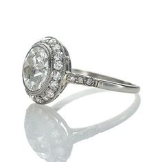 art deco engagement ring - an Old European cut diamond weighing 2.01 cts and certified by the GIA as J color and VVS2 clarity (GIA #5141977068) is circled by a delicate frame of eighteen round diamonds. The low crown has a filigree gallery and six additional diamonds set into the shoulders. A vintage treasure from the 1920s.