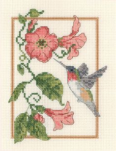 Hummingbird on Flowers in counted cross stitch ...  I stitched my picture in 2010 using this chart from Candamar Designs. Pretty in the bedroom.