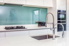 Our beautiful Nolte Handleless Kitchen in Feel White and Quartz Grey - Adjourned with aqua blue glass splash backs and a Quooker tap! Kitchen Ideas, Kitchen Design, Handleless Kitchen, German Kitchen, Bespoke Kitchens, Aqua Blue, Sink, Vanity, Quartz