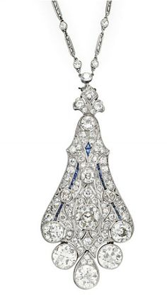 A BELLE EPOQUE DIAMOND AND SAPPHIRE PENDANT NECKLACE   The old European-cut diamond and platinum wirework chain, suspending a detachable pierced old European-cut diamond tapered pendant, bezel-set with larger old European-cut diamonds and three diamond drops, mounted in platinum, circa 1915, 25½ ins., (pendant may also be worn as a brooch)