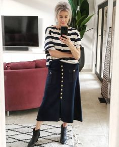 Striped top worn with midi skirt and booties | Photo by Suzie Richetti (@suzie.richetti)| For more style inspiration visit 40plusstyle.com