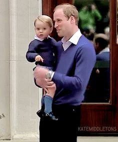 Prince William and Prince George going in to see Kate and Charlotte