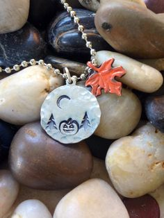 handstamped and hammered with halloween scene an pendent accents strung