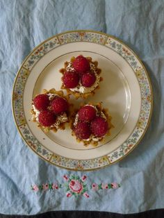Raspberry Tarts with a pistachio cardamon crust