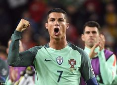 Ronaldo celebrates in front of the travelling Portugal fans after the final whistle in Budapest