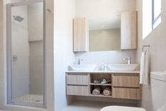A small scale home in a quiet cul-de-sac in Langebaan Country Club, which overlooks the Langebaan Country Eco Estate with total privacy Bathroom Vanity Designs, Bathroom Vanity Cabinets, Storage Boxes, Cabinet Storage, Building Contractors, White Granite, Timber Wood, Grey Glass, Storage Design