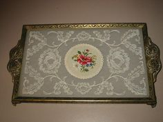I could make these with picture frames... Could be used as placemats for parties, too! English Embroidered Glass and Filigree Vanity Tray Vintage