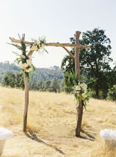 arch made from branches with fresh flowers