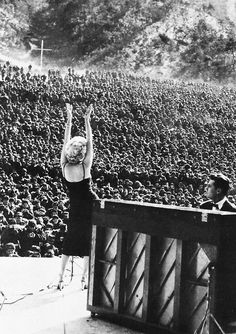 Marilyn Monroe performing for troops stationed in Korea, February 1954  Notice the Cross in the back of the Troops. Description from pinterest.com. I searched for this on bing.com/images