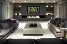I simply love how classy the mono chromatic look in this room has!!! I also like that below the TV long fireplace idea!