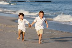 Let's make a run for it! Brothers at the beach. Children's portraits ~ DeborahKalasPhotography.com ~ The Hamptons, New York and Palm Beach, Florida.