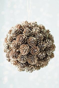 "DIY Craft - pinecone ""kissing ball"" - use styrofoam ball, glue on cones, frost with spray ""snow"", insert hanger Noel Christmas, Winter Christmas, All Things Christmas, Christmas Ornaments, Christmas Wedding, Pinecone Christmas Crafts, Diy Ornaments, Christmas Fashion, Ball Ornaments"