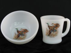 """Fire King Vintage Mallard Duck Cereal/Chili Bowl and Mug.     What a find - I love Fire King and I love ducks. Here they are together!     This attractive vintage set was produced by Hocking in the 1950's or 1960's.  The bowl measures 5"""" wide and 2 14"""" high and is known as the cereal or chili bowl.  The mug measures 3 3/8"""" high and 3 1/4"""" wide.    Both pieces are opaque or milk white and have a mallard duck decal decoration."""
