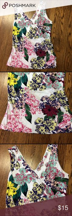 CAbi sleeveless stretch floral bouquet tank sz XL So cute and so comfy! V neck in the front and back! CAbi is nice brand! It's size XL. This top is soft and strechy and has thick straps so you can wear a regular bra! CAbi Tops Tank Tops