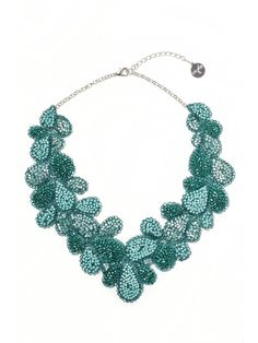 Turquoise and other tone beads, crocheted into petals, crafted by artisans from Brazil