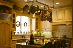 country style kitchen decor - pan hangers!