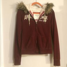 Abercrombie A&F Sherpa Lined Zip-Up Hoodie w/ Fur Worn only a few times. Fur is still in great shape. Maroon colored. Women's Medium. Abercrombie & Fitch Sweaters