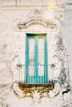 turquoise window with balcony